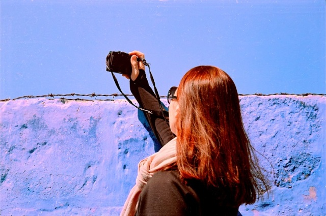 a beautiful photographer in fields of a blue poem
